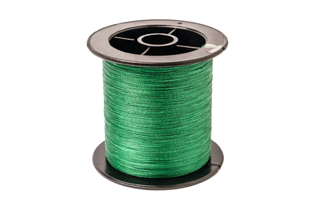 Spool of green cord on white background. Spool of braided fishing line.