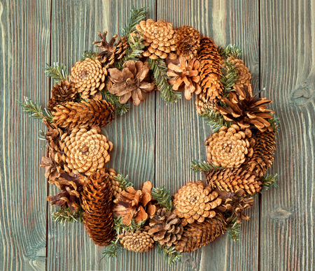 Christmas wreath on wooden background as Christmas decoration.