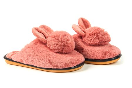 Cute warm fluffy women's Bunny Slippers isolated on white background.