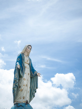 The Blessed Virgin Mary Statue blue sky background. Stock Photo