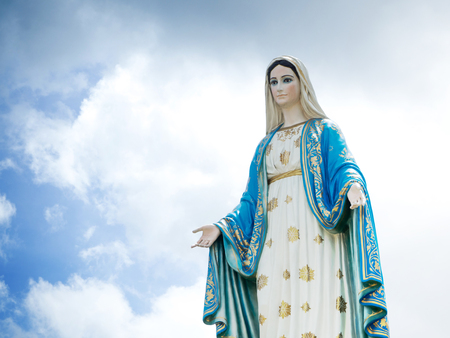 The Blessed Virgin Mary Statue blue sky background. Imagens
