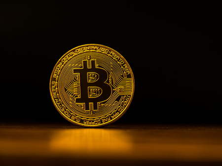 Golden bitcoin cryptocurrency banking money transfer business technology with black background. Concept of distributed ledger technology and digital electronic binary money financial.