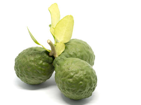 close up group of fresh bergamot with green leaves isolated on white background. benefits of bergamot for beauty and health concept