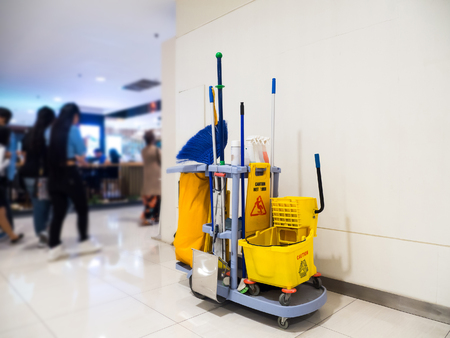 Cleaning tools cart wait for cleaning.Bucket and set of cleaning equipment in the Department store Banco de Imagens - 93152923