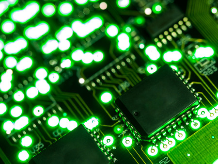 Abstract background,close up green circuit board. Electronic computer hardware technology. Mainboard computer background. Integrated communication processor. Information engineering component.
