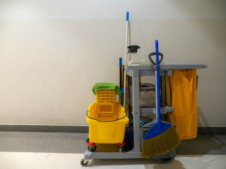 Cleaning tools cart wait for cleaner.Bucket and set of cleaning equipment in the Department store. janitor service janitorial for your place. Concept of service, worker and equipment for cleaner