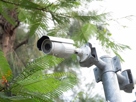 CCTV security camera installed in village for security guard monitoring and surveillance for not let bad things happen. Standard-Bild - 110368139