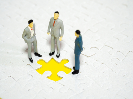 businessman standing in front of  missing piece jigsaw on the yellow background. Standard-Bild - 110368197