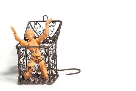 Action figure sitting and hold two hands above the head in open steel cage on isolate background, Concept of tolerance in comfort zone do not dare to change and Fear of change Standard-Bild - 110368201