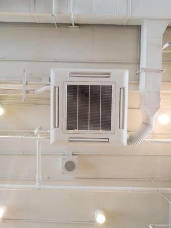 White Industrial air conditioner cooling pipe with plumbing at ceiling. Ventilation system ceiling air duct. Standard-Bild - 110368210