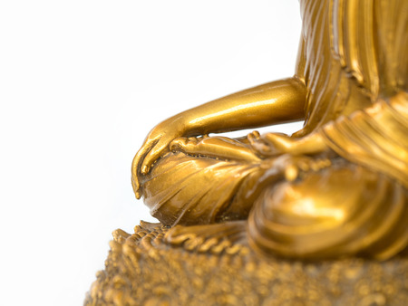 The part of golden antique buddha statue on the white background (isolated background). copyspace for text and content