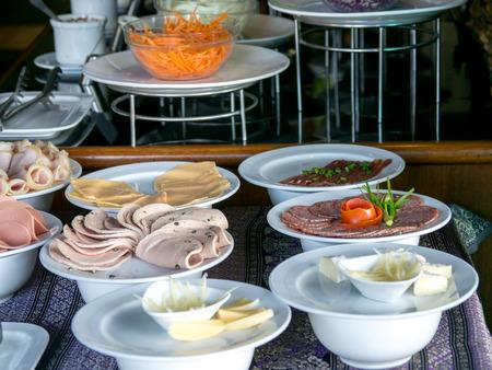 Buffet meal at a hotel,appetizer. Hotel breakfast board all you can eat buffet Standard-Bild - 110368279