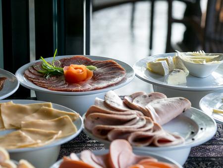 Buffet meal at a hotel,appetizer. Hotel breakfast board all you can eat buffet Standard-Bild - 110368283