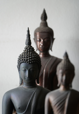 select focus of vintage black ancient buddhas statue in the middle of other buddhas statue Standard-Bild - 110368287