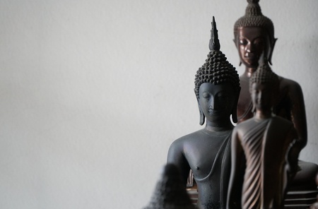 select focus of vintage black ancient buddhas statue in the middle of other buddhas statue Standard-Bild - 110368289