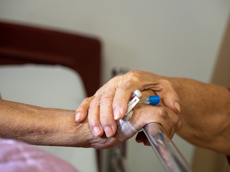 Wife visiting husband in hospital. Senior couple holding hands on hospital bed for hospitalization for supporting his dear. Concept of love and to be with lover. Standard-Bild - 110721300