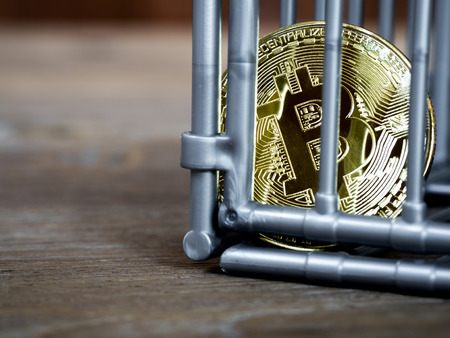 The coin is in the gray nick color put on a wooden table. The concept of investment and fluctuation of bitcoin and cryptocurrency. Standard-Bild - 110721303