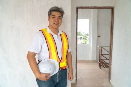 Asian professional engineer workering in house construction site for inspection of the cottage under construction Stock fotó - 132037739