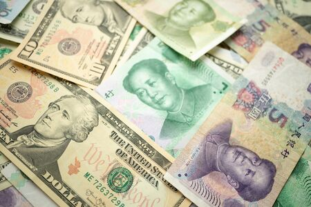 Select focus of 10 US dollar stack under China yuan banknote. Concept of Trade war between the United States and China. Reklamní fotografie