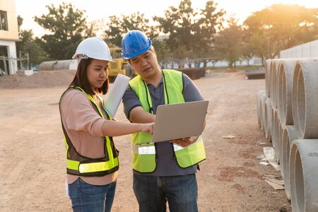 Asian woman construction engineers are checking construction specifications in laptops with technical engineers