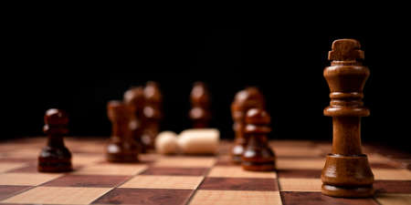 Brown king standing confront of Chessboard. New business players are facing challenges. The management or leadership, analysis, strategy concept. Фото со стока