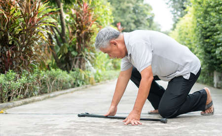 Asian senior man falling down at home in the backyard caused by myasthenia (Muscle Weakness) and the nurse came to help support. Concept of old elderly insurance and health care 스톡 콘텐츠