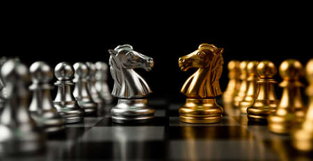Golden and silver horse chess pieces Invite face to face and There are chess pieces in the background. Concept of competing, leadership and business vision for a win in business games