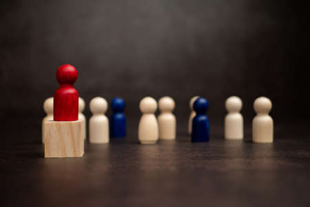 The leadership of the wooden figure standing on the box show influence and empowerment. Concept of business leadership for leader team, successful competition winner and Leader with strategy Stock Photo