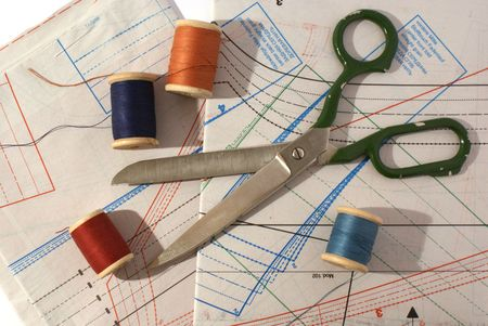 Scissors, sewing patterns and a measuring tape photo