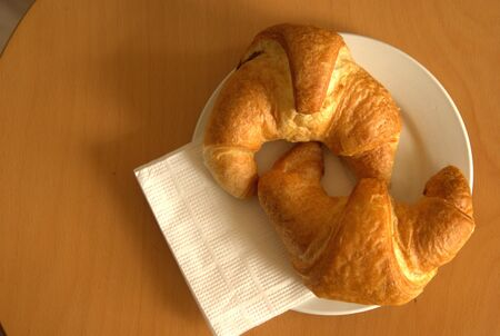 Two croissants on a plate photo