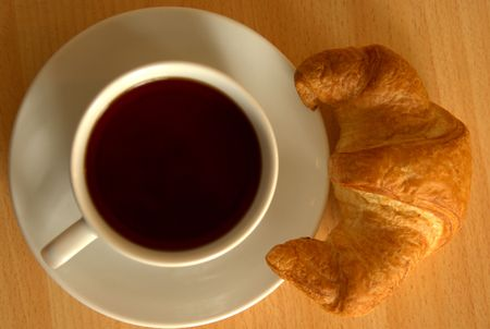 Croissant and a cup of tea photo