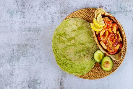 Spinach tortillas with fajita and avocado. Mexican cuisine.