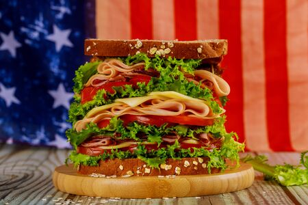 Sandwiche with american flag on background for american holiday party. Independence day concept. Foto de archivo - 137865828