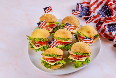 Celebration american holiday with sandwiches and american flag. Freedom America, Independence Day.