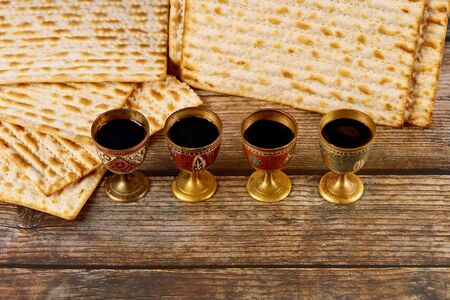 Matzah and four cups full of wine. Jewish holidays Passover concept.
