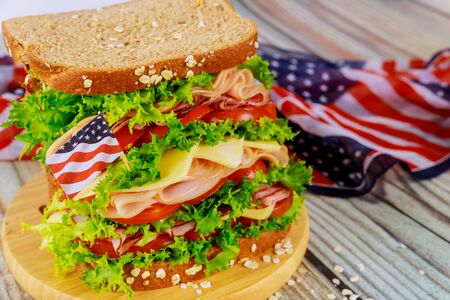 Sandwiche with american flag on background for american holiday party. Independence day concept.