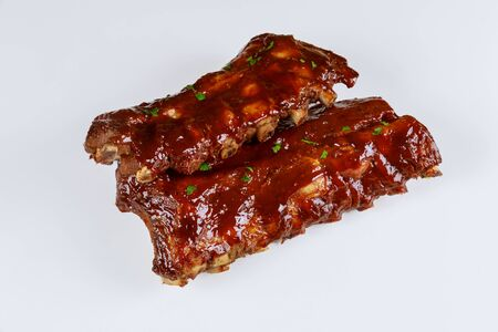 Hickory smoked barbecue beef ribs on isolated white background.