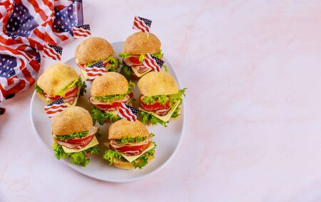 American holiday appetizer ciabatta roll sandwiches on white background with flag.
