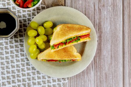 Healty grilled cheese sandwich with cup of coffee and golden grape. Stock fotó