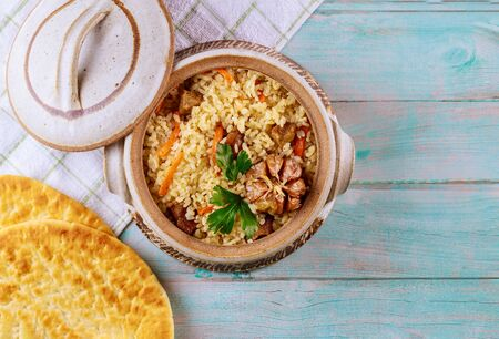 Arabic dish rice, meat with curry, carrot and pita bread.