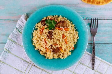 Delicious lunch with stewed rice ,meat and carrot. Eastern food.