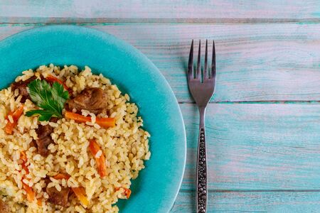 Pilaf with rice , curry spice, carrot and meat. Russian cuisine. Stock fotó