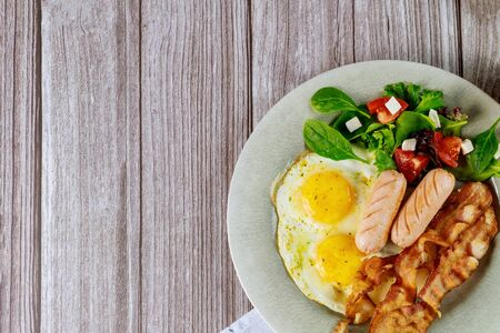Dish with breakfast delicious meal on wooden background. Stock fotó