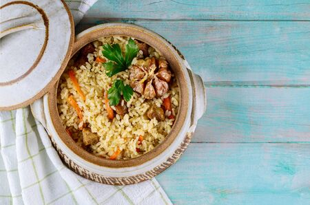 Pilaf with carrot, garlic and meat. Uzbek cuisine.