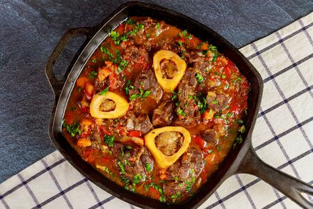 Cooked beef shank with vegetable and wine. Ossobuco Italian cuisine.