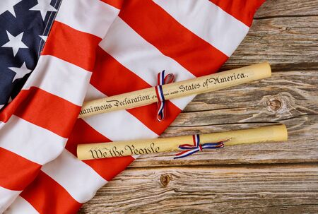 Fourth of July Day. Declaration of Independence parchment roll document with US flag on white background.