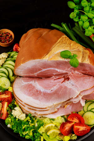 Sliced ham with fresh salad close up. Top view.