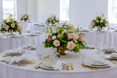 Wedding decoration table set. Arrangement of fresh nature flowers .