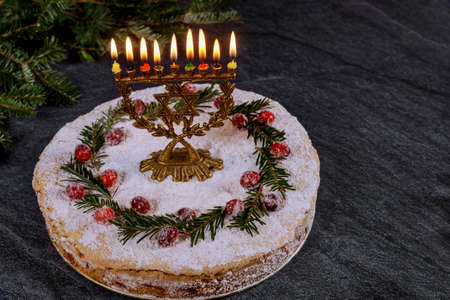 Hanukkah cake with burning menorah on the top. Standard-Bild