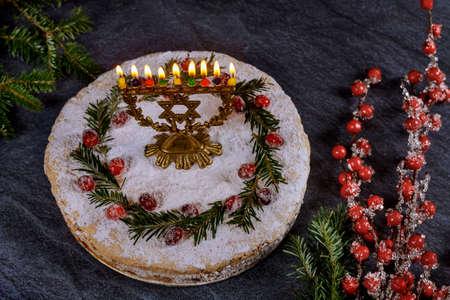 Hanukkah cake with burning menorah on the top.